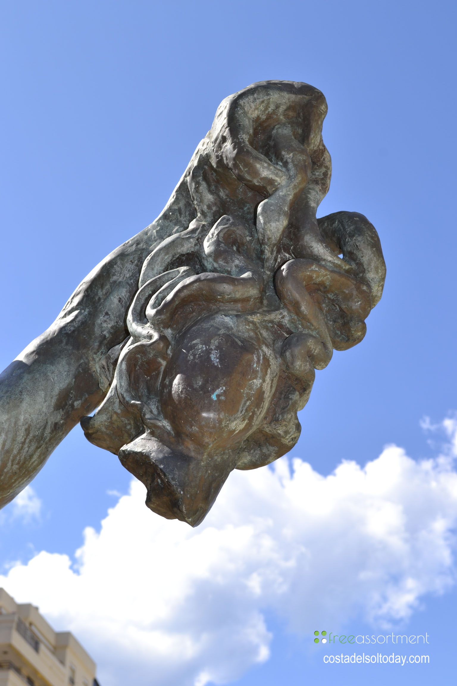 The head of Medusa, held by Perseus, bronze statue by Salvador Dali on the Avenida del Mar in Marbella, Spain - One of ten spectacular Dali sculptures 02